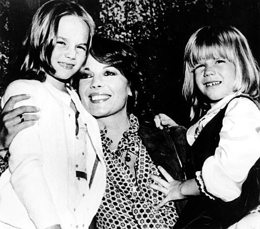 Actress Natalie Wood holds her two children Natasha, left, and Courtney at a studio party in Los Angeles.
