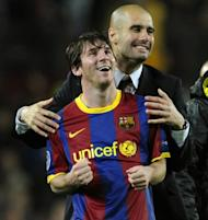 Barcelona's coach Josep Guardiola (right) celebrates with Argentinian forward Lionel Messi after the Champions League semi-final second leg football match between Barcelona and Real Madrid at the Camp Nou stadium in Barcelona on May 3, 2011. Guardiola, architect of one the greatest eras in the club's history, has reportedly told players he is leaving at the end of this season