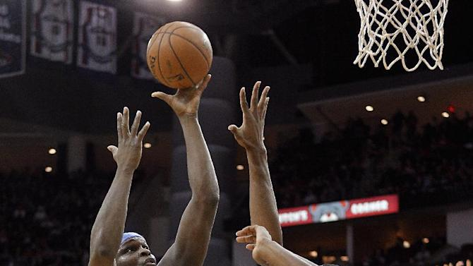 Memphis Grizzlies forward Zach Randolph, left,  drives to the basket as Houston Rockets guard James Harden (13) watches during the first half of an NBA basketball game Thursday, Dec. 26, 2013, in Houston