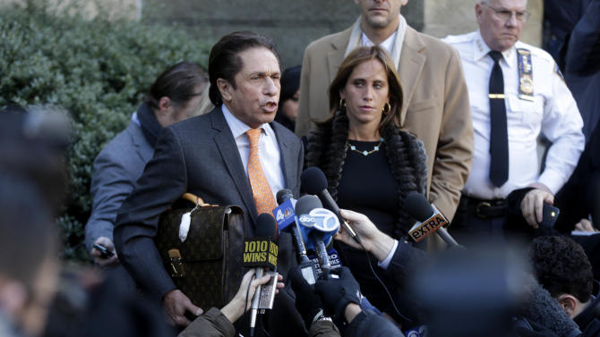 Mark Heller, an attorney for actress Lindsay Lohan, leaves the courthouse, Monday, Jan. 7, 2013, in New York. Heller signed paperwork at the courthouse in connection with Lohan's alleged fight at a Manhattan nightclub on Nov. 29, 2012. (AP Photo/Seth Wenig)