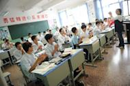 School boys listen to their teacher at the government-run Number Eight High School in Shanghai, on October 15, 2012. The city's school system topped the Organisation for Economic Co-Operation and Development's (OECD) worldwide assessment tests of 15-year-olds in 2009