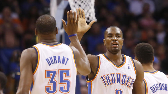 Oklahoma City Thunder forward Serge Ibaka (9) high fives teammate Kevin Durant (35) in the first quarter of an NBA basketball game against the Sacramento Kings in Oklahoma City, Sunday, Jan. 19, 2014. (AP Photo/Sue Ogrocki)