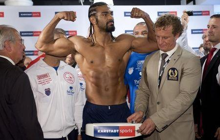 British Boxer and WBA champion Haye poses during his weigh-in in Hamburg July