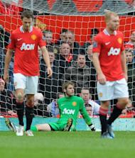 Manchester United's Dutch goalkeeper David de Gea (C) reacts after Everton's fourth goal during the English Premier League football match between Manchester United and Everton at Old Trafford in Manchester. The match ended in a 4-4 draw