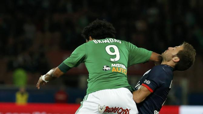St Etienne's Brandao challenges Paris St Germain's Cabaye during their French Ligue 1 soccer match at the Parc des Princes Stadium in Paris