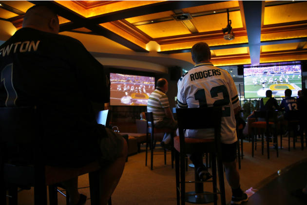 Australian NFL fans watch the telecast of the NFL Super Bowl on a large screen at the Western Suburbs Leagues Club in Leumeah, located west of Sydney, Australia