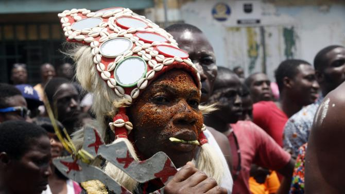 "Man from the ""Blessoue Djehou"" generation, dressed as a warrior, performs a combat dance during the Generation Festival in Anoumabo, in Abidjan"