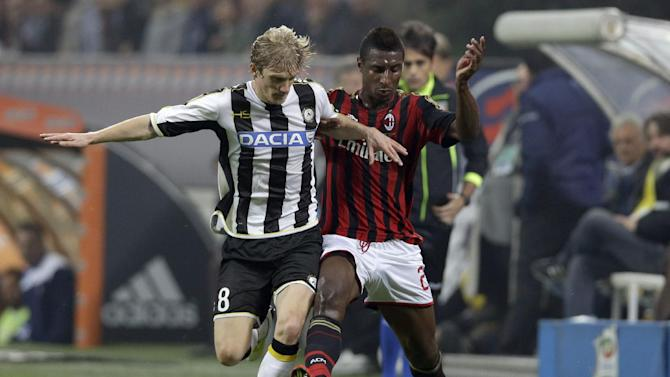 Udinese defender Dusan Basta, left, and AC Milan's Kevin Constant vie for the ball during a Serie A soccer match between AC Milan and Udinese, at the San Siro stadium in Milan, Italy, Saturday, Oct. 19, 2013