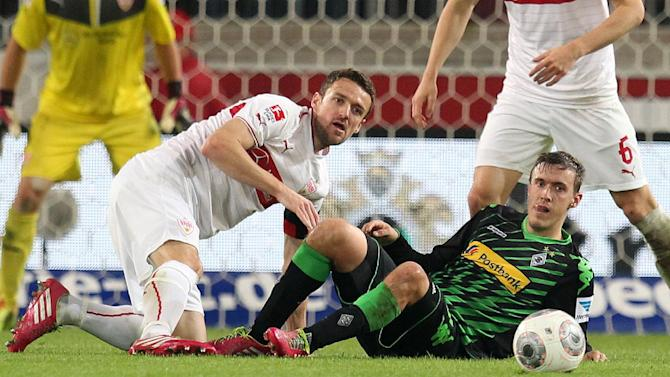 Stuttgart's Christian Gentner, left, and Moenchengladbach's Max Kruse challenge for the ball during the German first division Bundesliga soccer match between VfB Stuttgart and Borussia Moenchengladbach Stuttgart, Germany, Friday, Nov. 22, 2013