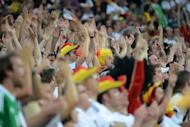 German fans cheer their team during the Euro 2012 football championships match Denmark vs. Germany, on June 17, at the Arena Lviv in Lviv. UEFA said on Monday that it had fined the German Football Federation (DFB) 25,000 euros ($31,000, 20,000 pounds) over the behaviour of its supporters during the country's final group stage match with Denmark