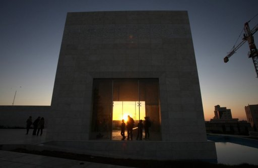 Palestinians gather to light candles at the mausoleum of Yasser Arafat in the West Bank city of Ramallah, on November 10. Swiss scientists who found abnormal levels of polonium on Arafat's personal effects will visit Ramallah this month for the exhumation of the late Palestinian leader's remains, a local newspaper reported Sunday