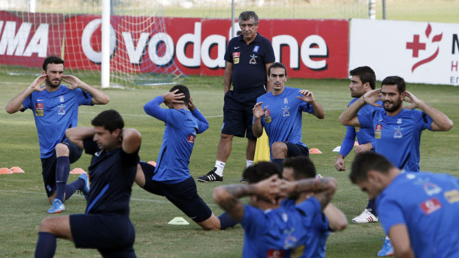 Greece's coach Fernando Santos from Portugal watches his players during a training session in Athens, Monday, Oct. 14, 2013, ahead of their 2014 World Cup Group G qualifying match against Liechtenstein on Tuesday