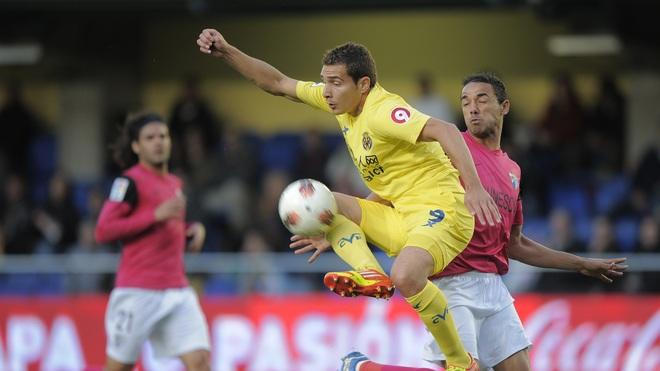 Malaga's Brazilian Defender Weligton  (R) Vies AFP/Getty Images