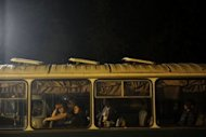 Victims of the floods rest in the a bus in Krymsk. Flash floods deluged Russia's southern Krasnodar, killing at least 134 people in the region's worst natural disaster in decades, officials and witnesses said Saturday