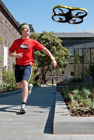 The Joggobot device flies above a runner, helping him keep pace. (Exertion Games Lab Facebook page)