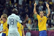 Swedish forward Zlatan Ibrahimovic (R) celebrates after scoring a goal during the Euro 2012 football championships match Sweden vs France at the Olympic Stadium in Kiev. France qualified for the knockout stages of a major finals for the first time in six years despite losing their final Euro 2012 Group D match 2-0 to already eliminated Sweden