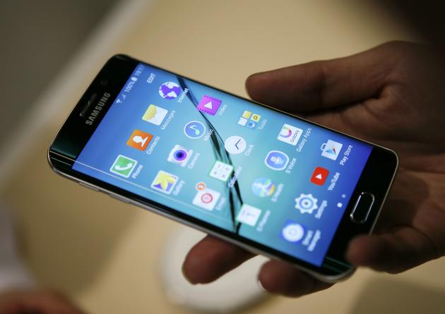 A hostess displays the Galaxy S6 edge at the Samsung Galaxy Unpacked event in Barcelona