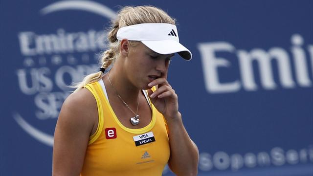 Injury ends Wozniacki's New Haven run