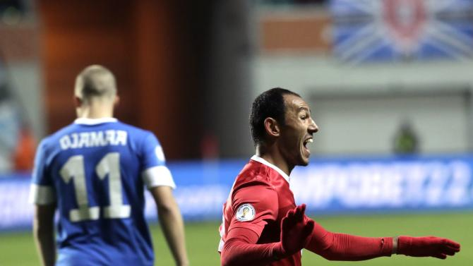 Bulut of Turkey celebrates after scoring a goal during their 2014 World Cup qualifying soccer match against Estonia in Tallinn