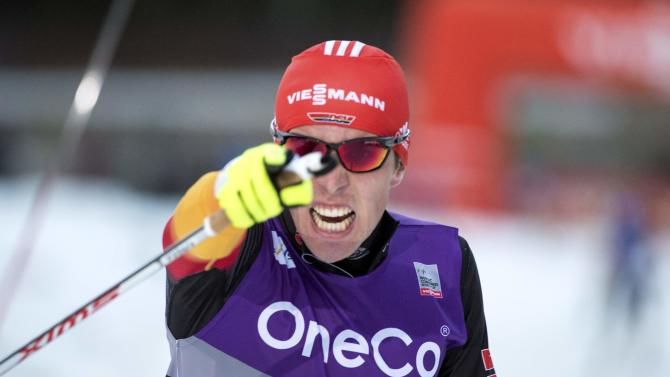 Rydzek of Germany celebrates after winning the WC Nordic combined competition in Trondheim