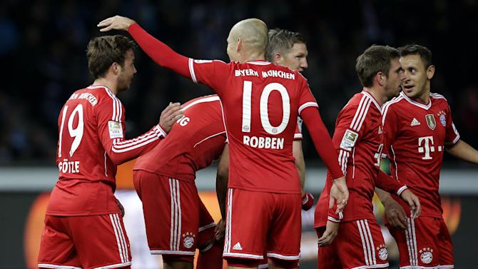 Bayern's Arjen Robben of the Netherlands, center, congratulates scorer Mario Goetze, left, during the German Bundesliga soccer match between Hertha BSC Berlin and Bayern Munich in Berlin, Germany, Tuesday, March 25, 2014