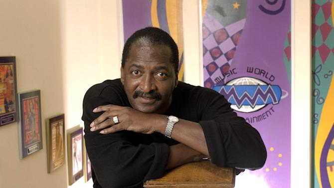 FILE - In this Dec. 8, 2003 file photo, Mathew Knowles, father and former manager of singer Beyonce Knowles, poses at his Music World Entertainment headquarters in Houston. Knowles married former model Gena Charmaine Avery, 48, in Houston, Texas on Sunday, June 30, 2013. (AP Photo/David J. Phillip, file)