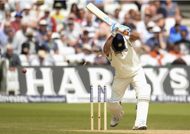 India's Dhoni is bowled by England's Plunkett for 11 runs during the first cricket test match at Trent Bridge cricket ground in Nottingham