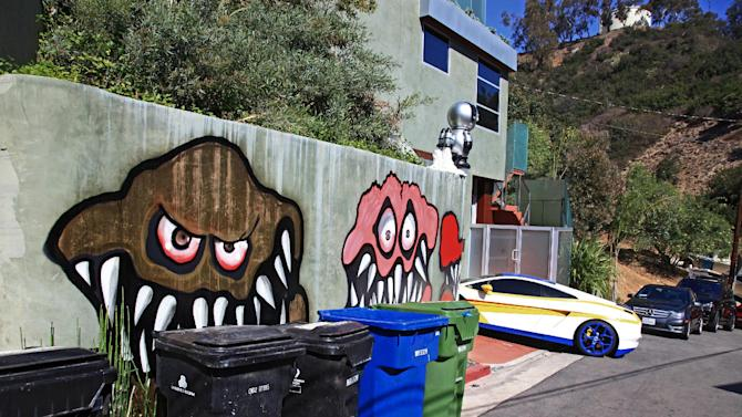 This Sunday May 12,2013 photo shows a mural painted on the outside of the Grammy-winning musician Chris Brown's neighbors are unhappy with what some are calling frightening art he's chosen to have painted along the curb of his Hollywood Hills home of Chris Brown in Los Angeles. The Grammy-winning musician's neighbors are unhappy with what some are calling frightening art he's chosen to have painted along the curb of his Hollywood Hills home. (AP Photo/Richard Vogel)