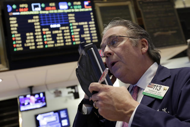 Trader Thomas Kay works on the floor of the New York Stock Exchange Wednesday, March 4, 2015. U.S. stocks are opening lower, putting the market on track for a second day of losses. (AP Photo/Richard D