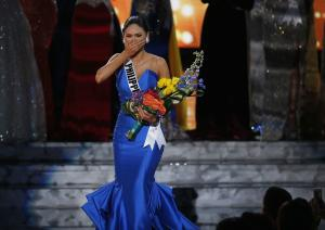 Miss Philippines Pia Alonzo Wurtzbach reacts as she…