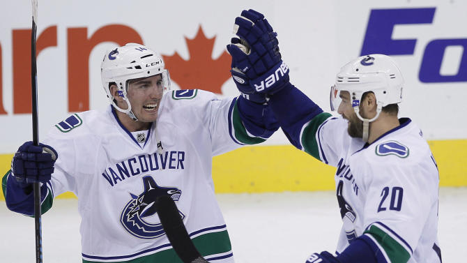 Chris Higgins lifts Canucks past Jets, 3-2