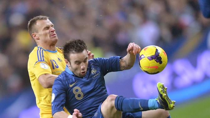 PARIS, Nov. 20, 2013 (Xinhua/IANS) -- Mathieu Valbuena (R) of France vies with Vyacheslav Shevchuk of Ukraine during the 2014 World Cup qualifying second leg playoff soccer match between France and Ukraine in Paris, France, on Nov. 19, 2013. France won 3-2 in total to be qualified for the final stage of the 2014 World Cup. (Xinhua/Chen Xiaowei)