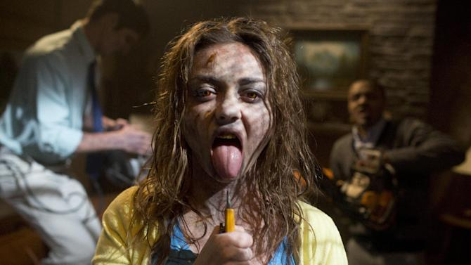 """This film publicity image released by Dimension Films/The Weinstein Co. shows Sarah Hyland in a scene from """"Scary Movie 5."""" (AP Photo/Dimension Films/The Weinstein Co., Peter Iovino)"""