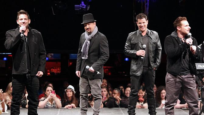 "In this picture provided by Starpix, from left, Jeff Timmons, Justin Jeffre, Nick Lachey, and Drew Lachey of 98 Degrees perform during the announcement of ""The Package Tour"", Tuesday, Jan. 22, 2013 in New York. The major summer tour will feature New Kids on the Block, 98 Degrees and Boyz II Men. (AP Photo/Starpix, Kristina Bumphrey)"