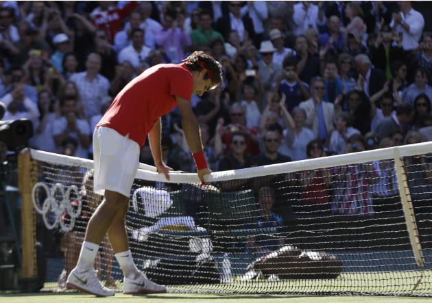 Roger Federer of Switzerland leans on the net after he defeated Juan Martin del Potro of Argentina at the All England Lawn Tennis Club in Wimbledon, London at the 2012 Summer Olympics, Friday, Aug. 3,