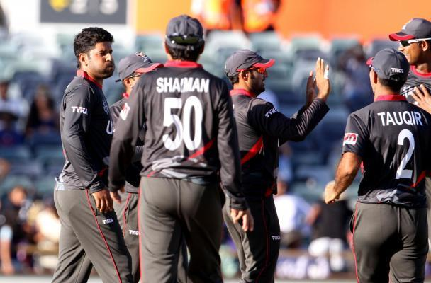 Perth: UAE cricketers celebrate fall of a wicket during an ICC World Cup 2015 match between India and UAE at Western Australia Cricket Association Ground, Perth, Australia on Feb 28, 2015. (Photo: IAN