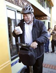 Apple Co-Founder Steve Wozniak, seen here riding a Segway as he holds the Apple's latest iPhone 4s he just purchased in Los Gatos, California, in October 2011. Wozniak told the Australian Financial Review that he and Apple co-founder Steve Jobs made decisions based purely on the motivation of making the best possible product, rather than impressing stakeholders