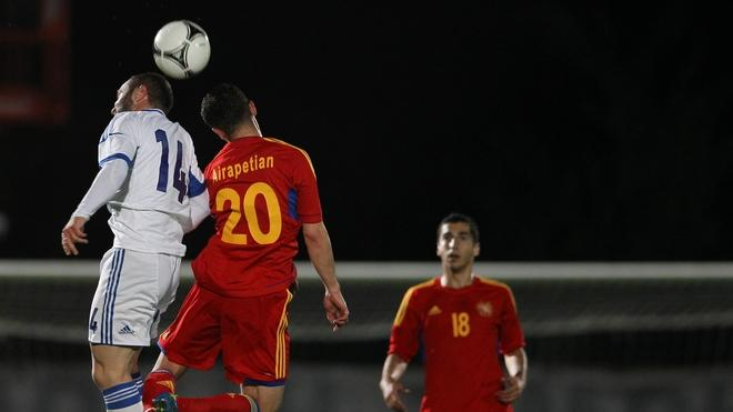 Greece's National Football Team Player Dimitrios Salpangidis (L) And Armenia's National Football Team Player Levon  AFP/Getty Images