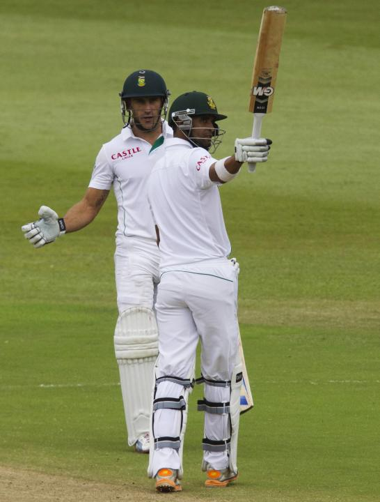 South Africa's Peterson celebrates scoring a half century with du Plessis looking on during the fourth day of the second test cricket match against India in Durban