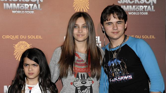 FILE - This Jan. 27, 2012 file photo shows, from left, Blanket Jackson, Paris Jackson, and Prince Michael Jackson at the opening night of the Michael Jackson The Immortal World Tour in Los Angeles. Michael Jackson's personal chef, Kai Chase, testified on Tuesday, June 18, 2013, about the home lives of the singer's children including an 11th birthday party that she says was Paris Jackson's last birthday celebration. Chase is testifying in a negligent hiring lawsuit filed by Jackson's mother against AEG Live LLC, claiming the company failed to properly investigate the doctor convicted of causing her son's 2009 death. (AP Photo/Dan Steinberg, file)
