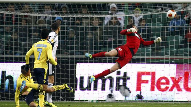 Perea of Lazio scores past goalkeeper of Kuciak of Legia Warsaw during their Europa League soccer match in Warsaw