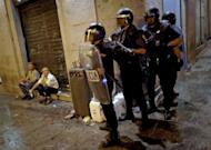 Riot police stand guard in Madrid after a protest against the Spanish government's latest austerity measures, on July 19, 2012. Spanish police fired rubber bullets and charged protestors in central Madrid early Friday at the end of a huge demonstration against economic crisis measures