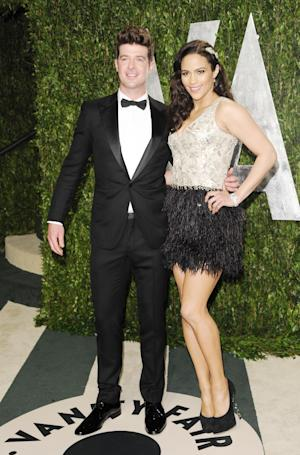 "FILE - In this Sunday, Feb. 26, 2012 file photo, singer Robin Thicke and wife actress Paula Patton arrive at the Vanity Fair Oscar party in West Hollywood, Calif. Robin Thicke wrote and produced the 2004 Usher song ""Can U Handle It,"" which features vocals from his wife, actress Paula Patton. He says though she can sing, Patton doesn't have plans to release her own music. (AP Photo/Evan Agostini, File)"