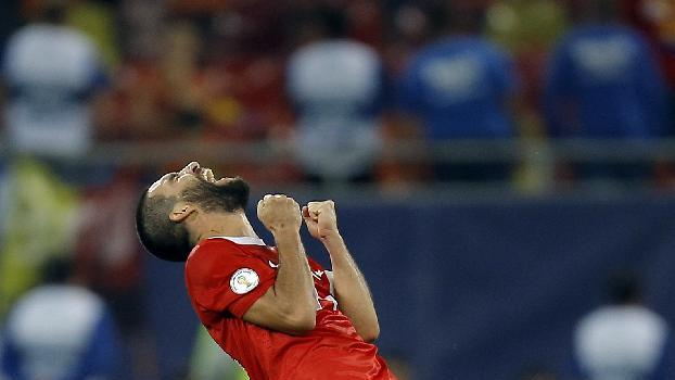 Turkey's Arda Turan celebrates at the end of a World Cup Group D qualifying soccer match between Romania and Turkey at the National Arena stadium in Bucharest, Romania, Tuesday, Sept. 10, 2013. Turkey beat Romania 2-0