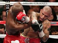 Miguel Cotto (R) grazes Floyd Mayweather during their WBA super welterweight title fight at the MGM Grand in Las Vegas, on Saturday, May 5. Mayweather won the title in a 12 round unanimous decision