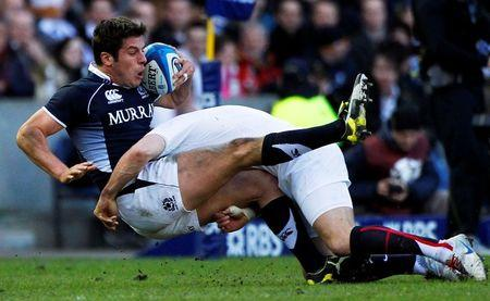 Scotland's Hugo Southwell is tackled by England's Mark Cueto during their Six Nations 'Calcutta Cup' rugby union match in Edinburgh, Scotland