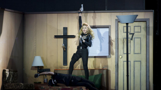 U.S. singer, Madonna, performs in Hyde Park, London, Tuesday, July 17, 2012. (AP Photo/Jonathan Short)
