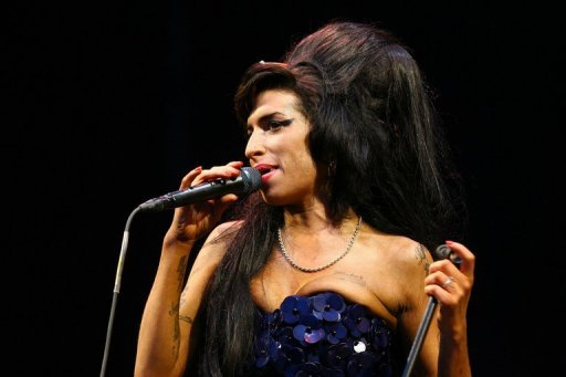 British singer Amy Winehouse performs at the Glastonbury Festival on June 28, 2008. A second inquest into the death of the troubled British singer confirmed Tuesday that she died of accidental alcohol poisoning.