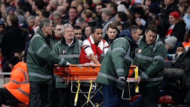 Theo Walcott was allegedly hit with items thrown from the crowd against Tottenham