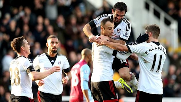 Fulham's Dimitar Berbatov celebrates with Giorgos Karagounis after scoring their second goal from the penalty spot (PA Sport)